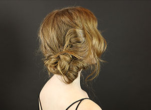how to create a messy side bun hairstyle step 6